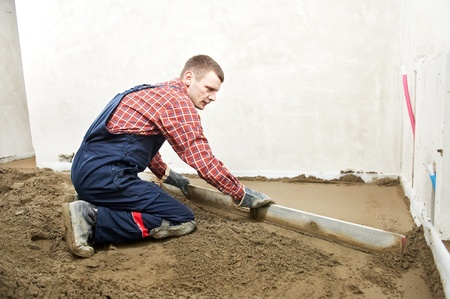 Plasterer concrete worker at floor work Stock Photo - 13536234
