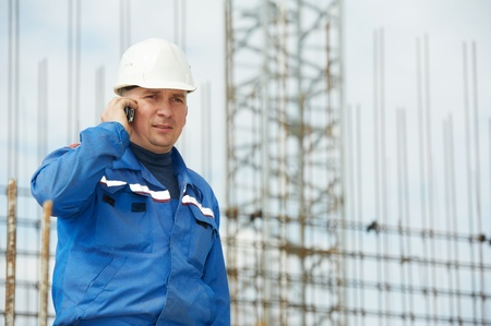 foreman at construction site with mobile phone Stock Photo - 13536187