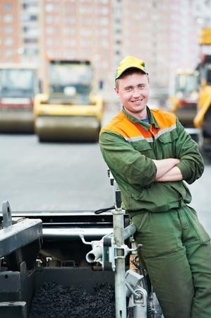 asphalting: worker at asphalting works Stock Photo