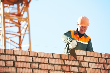 bricklayer: construction mason worker bricklayer Stock Photo