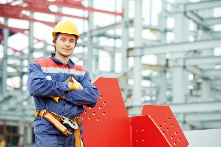 erector: builder worker at construction site Stock Photo
