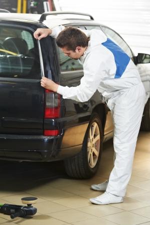 auto mechanic protecting car before polishing photo