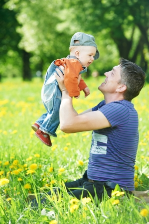 endearment: Father playing with child boy Stock Photo