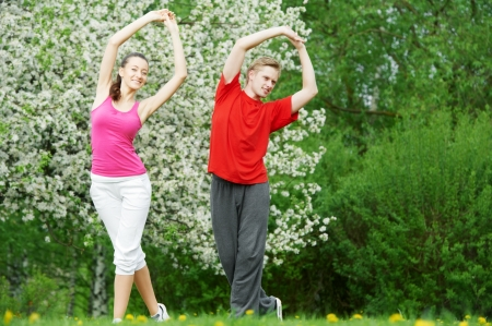 Young man and woman doing stretching exercises photo
