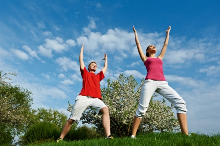 loosen up: Young man and woman doing stretching exercises