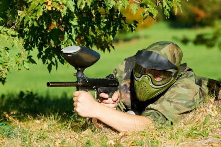 paintball: paintball player aiming with marker  Stock Photo