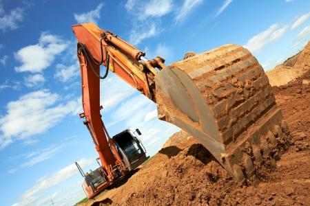 track-type loader excavator at work photo