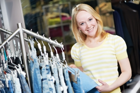 Young woman at clothes shopping store Stock Photo - 13701151