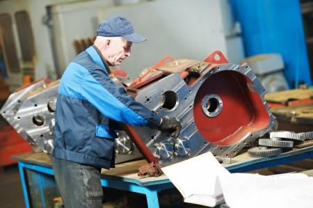 the assembler: experienced industrial assembler worker