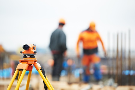 surveyor: surveyor equipment level at construction site