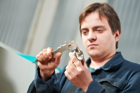 worker measuring detail with caliper Stock Photo - 13701379