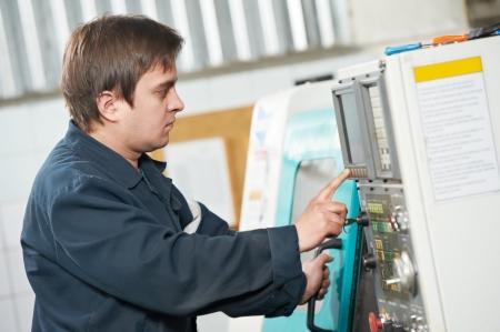 setup operator: worker at tool workshop Stock Photo