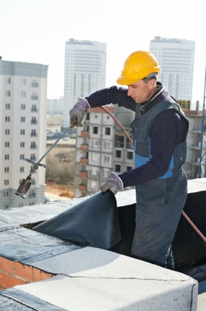 roofer: Flat roof covering works with roofing felt