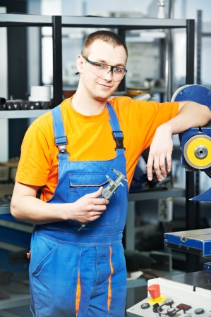 sliding caliper: worker at tool workshop Stock Photo