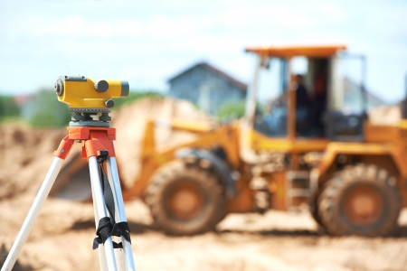 tacheometer: surveyor equipment level at construction site