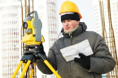 surveyor works with theodolite Stock Photo - 13701163