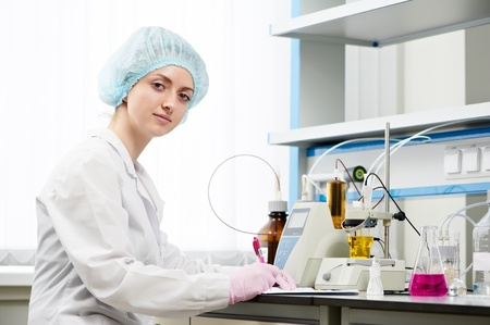 medical female pharmacy scientist in a laboratory photo