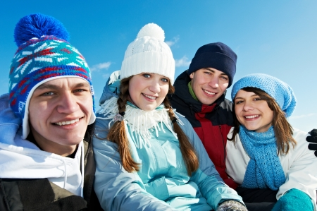 group of happy young people in winter photo