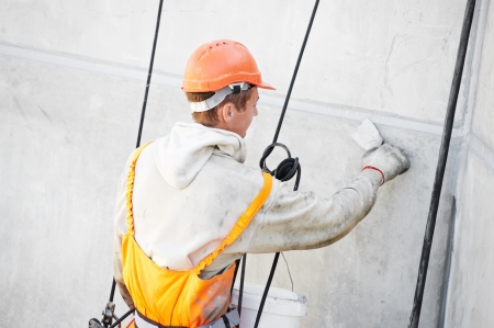 stucco facade: Facade Plasterer worker at work Stock Photo