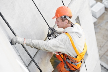 parget: Facade Plasterer worker at work Stock Photo