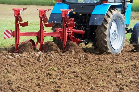 tillage: Ploughing tractor at field cultivation work
