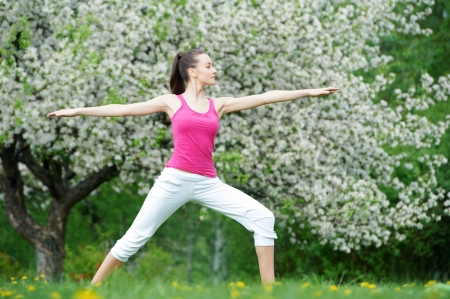 loosen up: Young woman doing stretching exercises outdoors