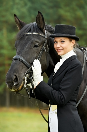 horsewoman jockey in uniform with horse Stok Fotoğraf