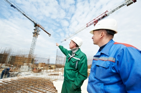 taskmaster: Engineers builders at construction site