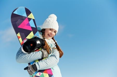 Happy sportswoman with snowboard photo