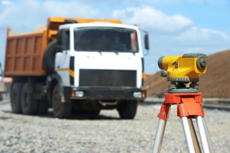 tachymeter: surveyor equipment level at construction site