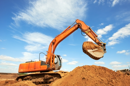 track-type loader excavator at work photo