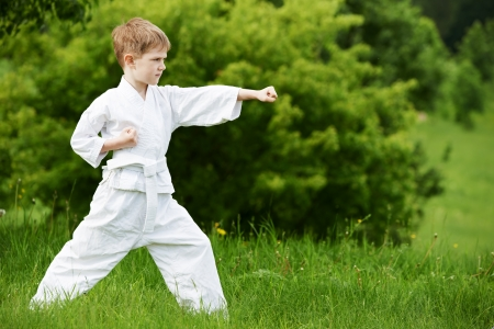 aikido: Little boy make karate exercises Stock Photo