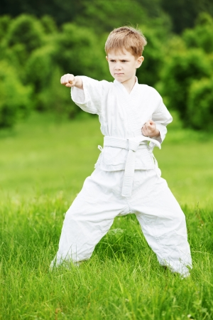 kata: Little boy make karate exercises Stock Photo