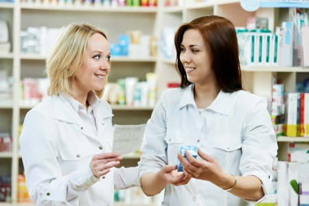 Pharmacy chemist women in drugstore photo