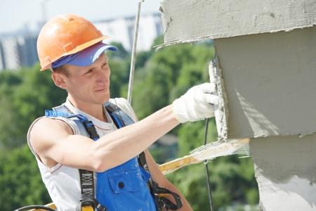 plasterer: facade builder plasterer at work Stock Photo