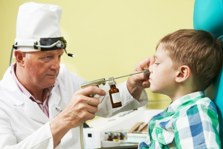 Little boy at ear nose throat doctor Stock Photo - 14018673