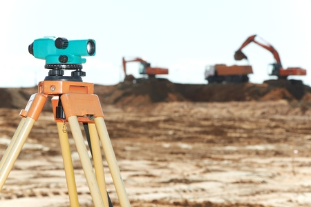land surveying: surveyor equipment level at construction site