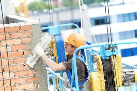 facade builder plasterer at work photo