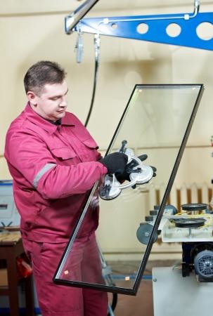 double glazing: glazier worker with glass