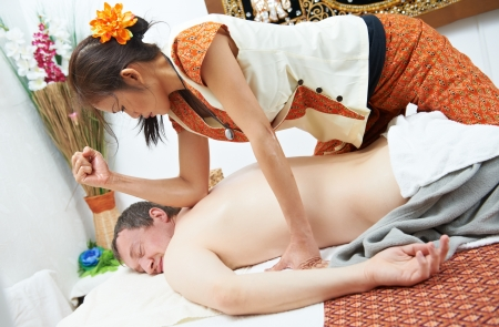 traditional wellness: Traditional thai massage health care back kneading