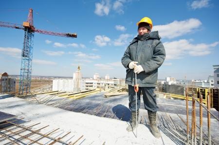 exact position: Surveyor builder at work