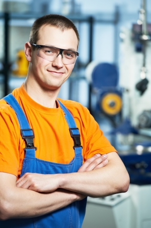 machinist: Portrait of experienced industrial worker