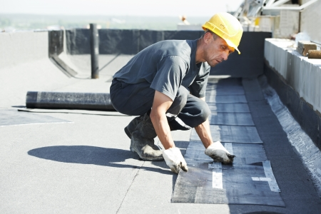 roofing: Flat roof covering works with roofing felt