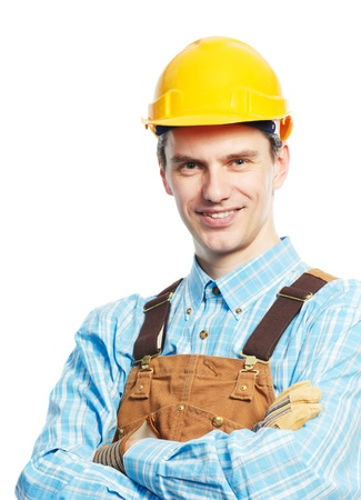 Happy worker portrait in hardhat and overall photo