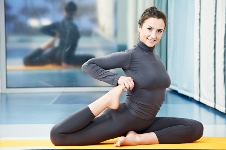 Happy smiling woman at gymnastic fitness exercise photo