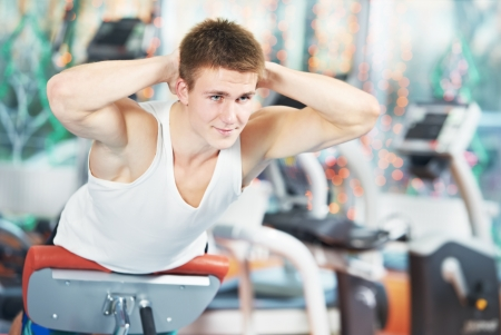 bodybuilding man at abdominal crunch exercises Stock Photo - 14051353