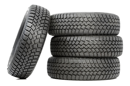 Stack of four car wheel winter tires isolated Stock Photo - 14056977