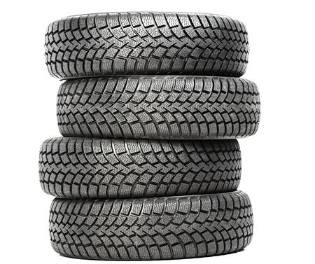 huellas de neumaticos: Pila de cuatro neumáticos de invierno de coches de ruedas aisladas Foto de archivo