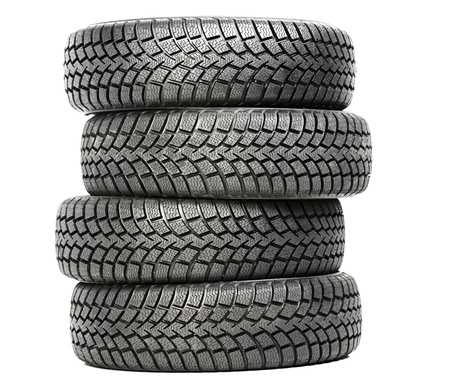 Stack of four car wheel winter tires isolated photo