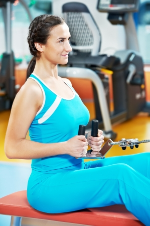 Happy woman with at training gym photo